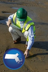 massachusetts an environmental engineer wearing a green safety helmet