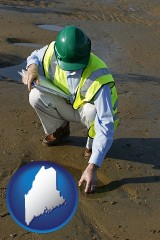 maine an environmental engineer wearing a green safety helmet