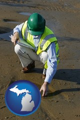 michigan map icon and an environmental engineer wearing a green safety helmet