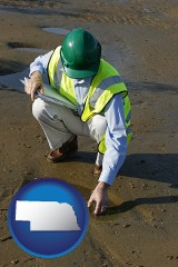 nebraska map icon and an environmental engineer wearing a green safety helmet