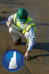 new-hampshire an environmental engineer wearing a green safety helmet