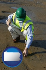 pennsylvania map icon and an environmental engineer wearing a green safety helmet