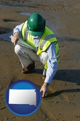 south-dakota map icon and an environmental engineer wearing a green safety helmet
