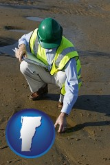 vermont map icon and an environmental engineer wearing a green safety helmet