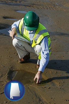 an environmental engineer wearing a green safety helmet - with Alabama icon
