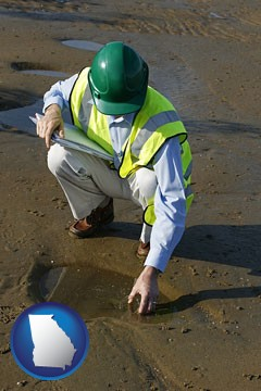an environmental engineer wearing a green safety helmet - with Georgia icon